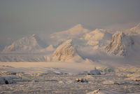 Mountains covered with snow and glaciers of the Antarctic Peninsula, a small snow storm