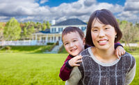 Chinese Mother and Mixed Race Child In The Front Yard of Custom House.