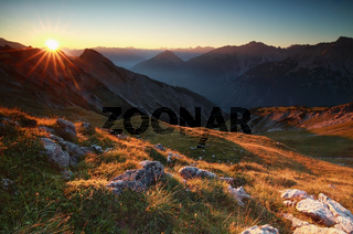 golden sunrise in high mountains