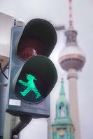 Green walking man (Ampelmann) in Berlin