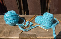 knitting of socks of blue wool
