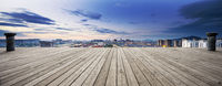 empty wooden floor and cityscape of modern city