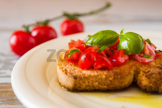 Closeup of bruschetta with tomato and basil