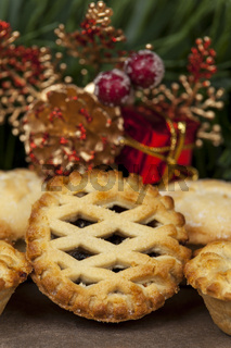 Lattice top mince pie and some christmas decorations