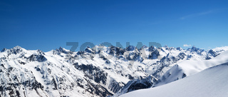 Panorama of snow mountains and off-piste snowy slope for freeride