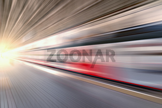 Modern high-speed train moves fast.