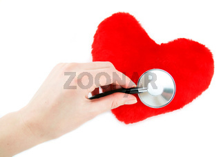 Hand with stethoscope checking a red heart isolated