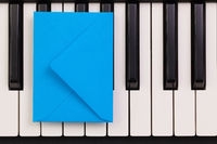 Funny arrangement envelope on the piano keybords