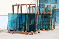 Window glass green on the stand prepared for replacement during the repair of a large business center.