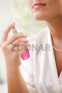 Female hand with perfume