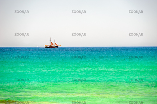 Sailing ship on sea horizon