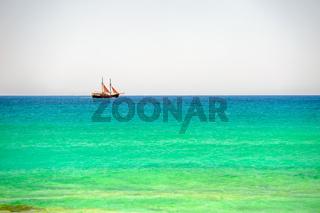 Sailing ship on sea horizon