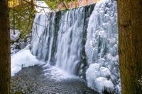 Wild waterfall in winter