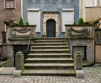 Solid stone steps to door of old house in Gdansk
