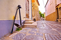 Old town of Krk stone street and old anchor view