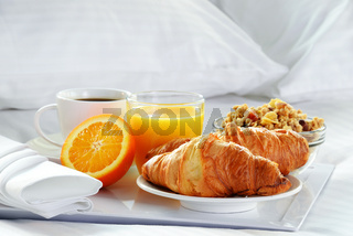Breakfast in bed in hotel room. Accommodation.