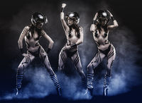 Rock and roll, woman with motorcycle helmet, naked girl dressed with black insulation ribbons on dark background