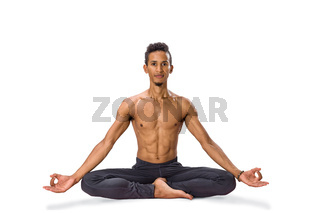 Young man meditating in Lotus position isolated
