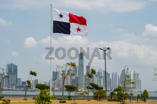 National flag of Panama with skyline of Panama City in background