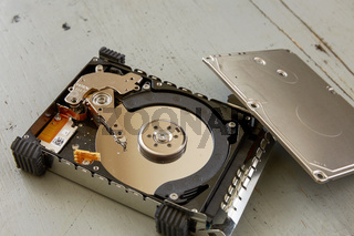 Close Up of Broken and Destroyed Hard Drive Disk on Wooden Table