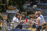 Girls Eating At A Restaurant In The Village Of Taormina Italy