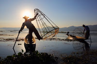 Traditional fishermen silhouette at Inle lake