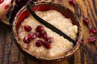 A bowl of tapioca pudding with vanilla and pomegranate
