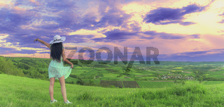 Brunette woman in nature at sunset