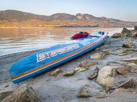 Racing stand up paddleboard on lake
