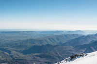 Panorama View of the summer northern caucasus from the snow-capped summit of Elbrus