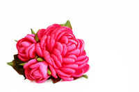 flower artificial handmade pink rose from satiny ribbons with buds on white background, isolated.