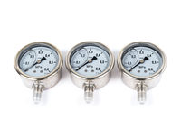 Close-up the group of three New Vibration-resistant manometer filled with glycerin. Manometers on isolated white background