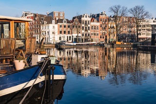 The reflections of Amsterdam and a houseboat
