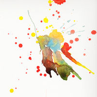 Multicolored watercolor splashes over white background
