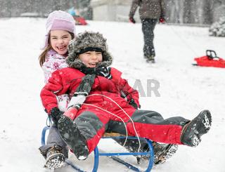 Kids Sledding Fun Snow