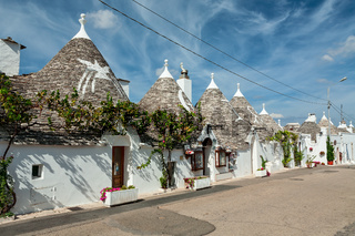Trulli houses in the shopping street in Alberobello, Puglia, Italy