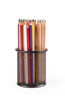 various pencils in metal grid container isolated