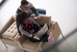 multiethnic couple shopping online