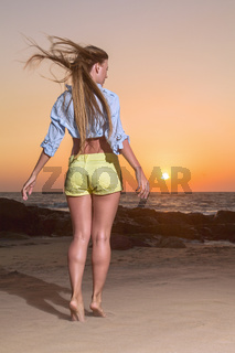 Young woman posing on the beach