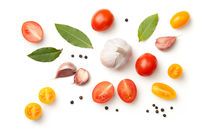 Tomatoes, Garlic, Bay Leaves and Peppercorn Isolated on White Background