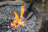 Hot metal arrow blade in the fire