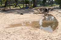 Sand Surin beach pollution from dirty drainage sewer pipe
