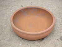 Clay pot on sand
