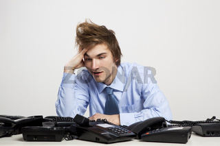 Tired man in the office