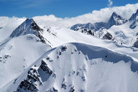 Snow-covered mountains with snow cornice