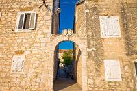 Mediterranean village of Zlarin stone architecture and gate view