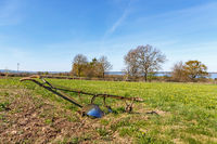 Horse-drawn plow in a field