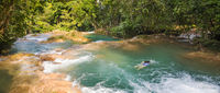 Woman Swimming At Agua Azul