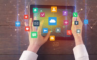 Hand using multitask tablet with application symbols and icons concept