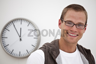 smiling man and a wall clock